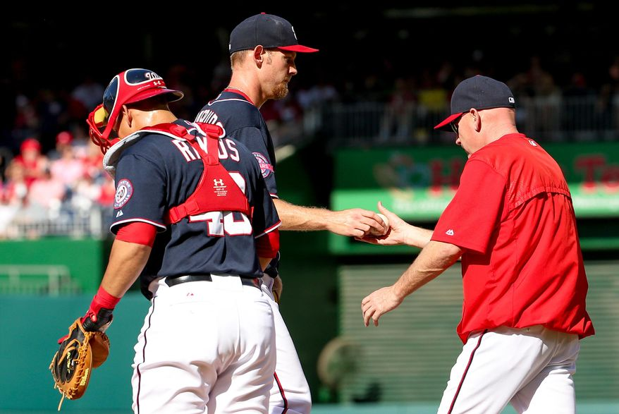 Washington Nationals manager Matt Williams, right, removes starting pitcher Stephen Strasburg during the fourth inning of a baseball game against the Philadelphia Phillies at Nationals Park, Saturday, May 23, 2015, in Washington. (AP Photo/Andrew Harnik)