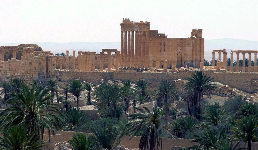 FILE - This file photo released on Sunday, May 17, 2015, by the Syrian official news agency SANA shows the general view of the ancient Roman city of Palmyra, northeast of Damascus, Syria. Members of the Islamic State group have captured the ancient town raising fears that the extremists will destroy its archaeological sites that have stood for two millennia. Palmyra, home to one of the Middle East's most famous UNESCO world heritage sites, was under full control of militants on Thursday after troops withdrew to nearby bases. (SANA via AP, File)