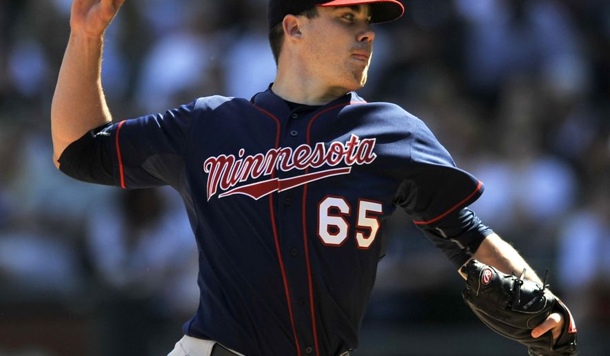 Minnesota Twins starter Trevor May pitches during the first inning of a baseball game against the Chicago White Sox, Saturday, May 23, 2015, in Chicago. (AP Photo/Paul Beaty)