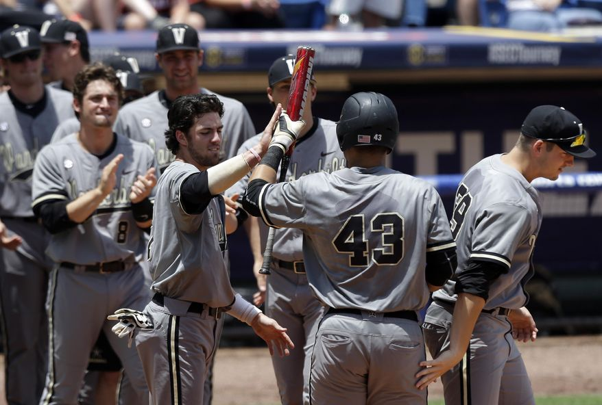 Vanderbilt's Zander Wiel (43) celebrates with teammates after hitting a home run against Texas A&M during the third inning of an NCAA college baseball game in the Southeastern Conference tournament, Saturday, May 23, 2015, at the Hoover Met in Hoover, Ala. (AP Photo/Butch Dill)