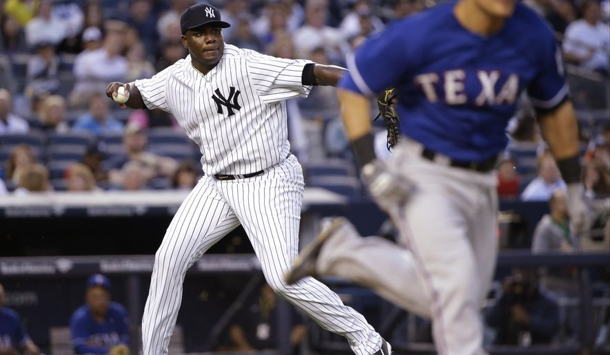 New York Yankees starting pitcher Michael Pineda looks to first as Texas Rangers' Tommy Field runs to first base during the third inning of a baseball game Friday, May 22, 2015, in New York. Fields was safe on the play. (AP Photo/Frank Franklin II)