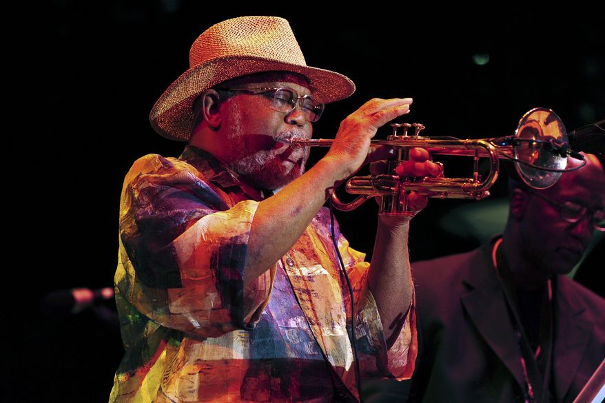 FILE - In this Sept. 2, 2012 file photo, trumpeter Marcus Belgrave performs at the 33rd annual Detroit Jazz Festival, in Detroit. Belgrave, a jazz trumpeter who graced stages and studios with Ray Charles, Aretha Franklin, Dizzy Gillespie, Joe Cocker and Motown artists galore, died Sunday, May 24, 2015. He was 78. (AP Photo/Detroit News, Ricardo Thomas, File)  DETROIT FREE PRESS OUT; HUFFINGTON POST OUT; MAGS OUT