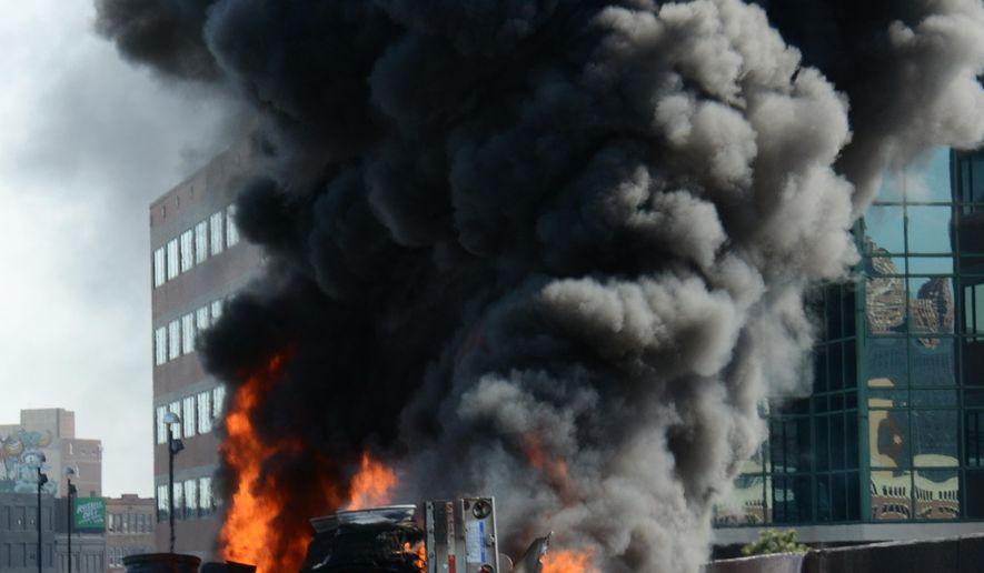 A tanker truck that was carrying 9,000 gallons of unleaded fuel burns after it exploded and caught fire on Interstate 75 in downtown Detroit Sunday, May 24, 2015. The driver wasn't hurt, but Interstate 375 at I-75 remained shut down as well as north I-75 in the area. (AP Photo/Bill Eisner)
