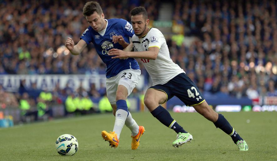 Everton's Seamus Coleman (Left) and Tottenham Hotspur's Nabil Bentaleb battle for the ball during the English Premier League soccer match at Goodison Park, Liverpool, England, Sunday May 24, 2015. (Clint Hughes/PA via AP) UNITED KINGDOM OUT  NO SALES  NO ARCHIVE