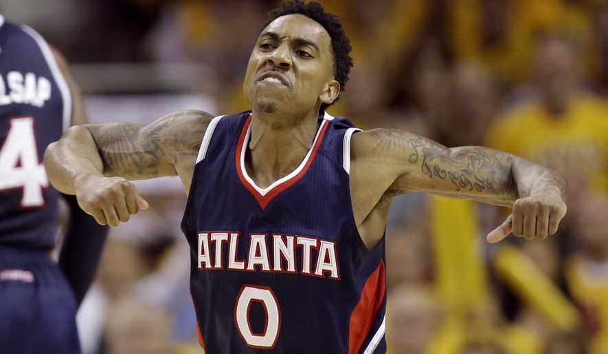 Atlanta Hawks' Jeff Teague (0) celebrates after hitting a shot against the Cleveland Cavaliers during the second half in Game 3 of the Eastern Conference finals of the NBA basketball playoffs Sunday, May 24, 2015, in Cleveland. (AP Photo/Tony Dejak)