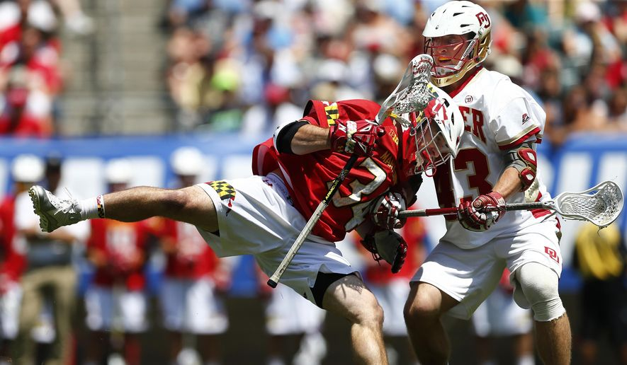 Maryland's Bobby Gribbin (34) runs into Denver's Christian Thomas (43) during the first half of the NCAA Division I men's lacrosse championship, Saturday, May 25, 2015, Philadelphia. (AP Photo/Rich Schultz)