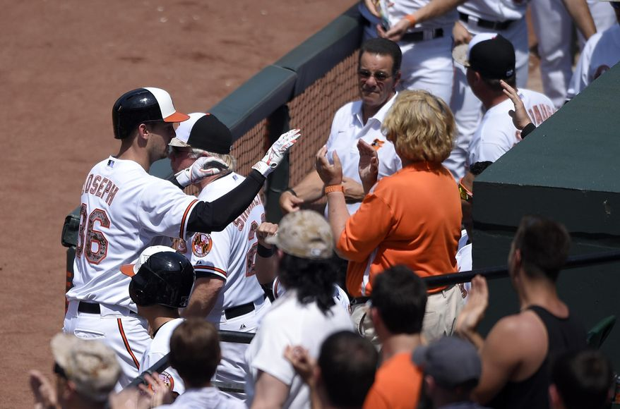 Baltimore Orioles' Caleb Joseph (36) celebrates his two-run home run against the Houston Astros during the second inning of a baseball game, Monday, May 25, 2015, in Baltimore. (AP Photo/Nick Wass)