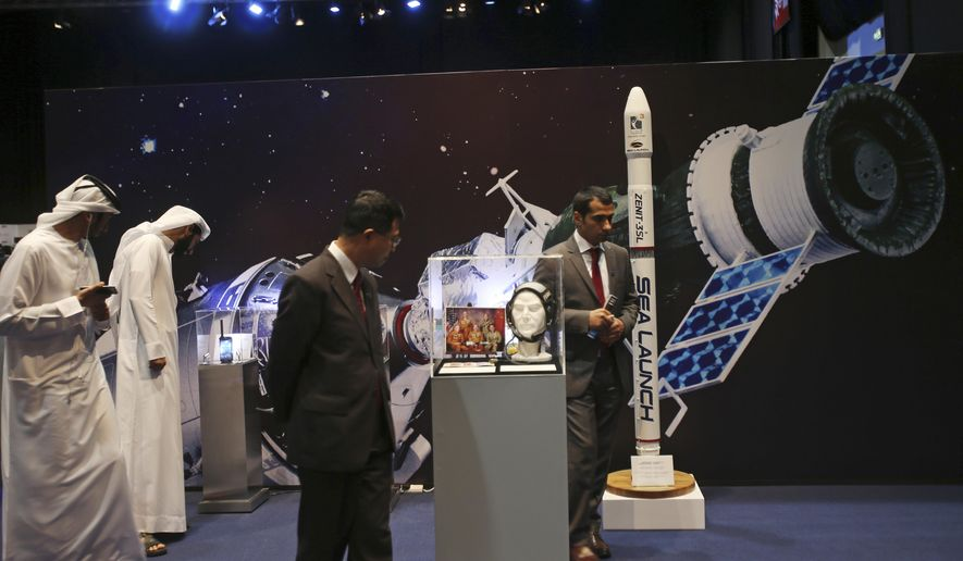 Emirati and other visitors visit the Space Museum during the launch of the UAE Space Agency strategic plan in Abu Dhabi, United Arab Emirates, Monday, May 25, 2015. The agency on Monday laid out a strategic framework for a newly created space agency that aims to integrate various arms of the Gulf federation's burgeoning space industry. The announcement comes less than three weeks after the Dubai-based team behind a 2020 mission to Mars announced that its probe will circle the planet studying its atmosphere, including changes over time and how surface features such as volcanoes, deserts and canyons affect it. (AP Photo/Kamran Jebreili)