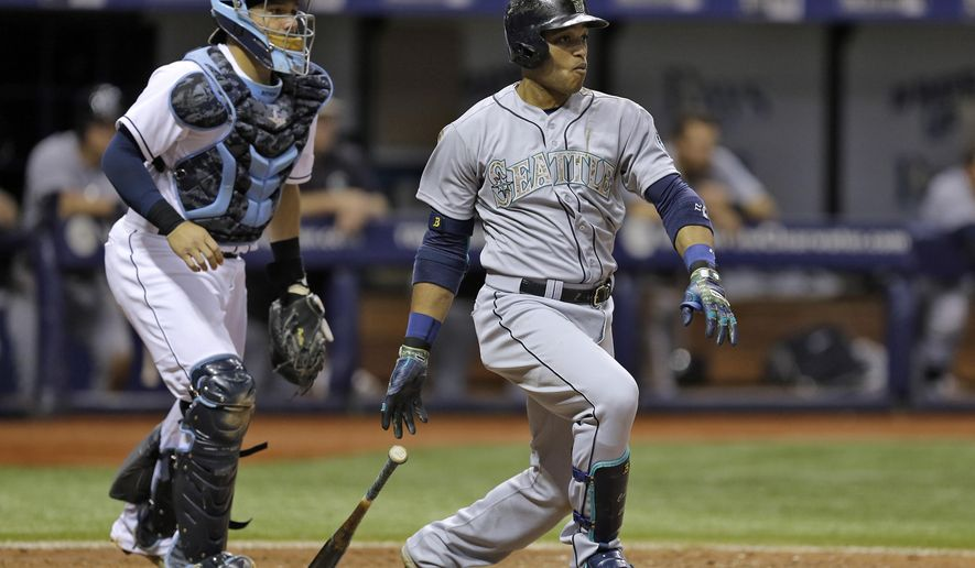 Seattle Mariners' Robinson Cano, right, watches his RBI single off Tampa Bay Rays relief pitcher Steven Geltz during the eighth inning of a baseball game Monday, May 25, 2015, in St. Petersburg, Fla.  Mariners' Seth Smith scored on the hit.  Catching for the Rays is Rene Rivera. (AP Photo/Chris O'Meara)
