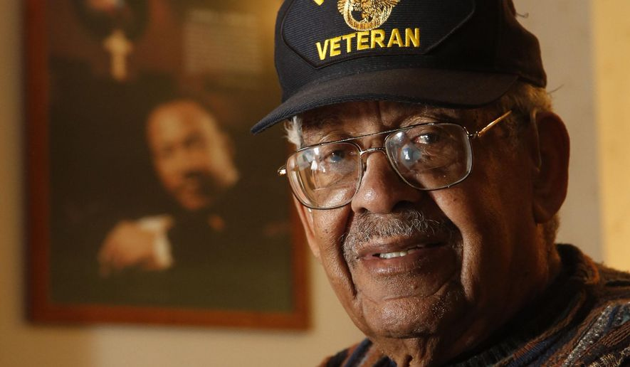 Charles W. Benning, a 92-year-old World War II veteran, left to fight the war in Europe before he could graduate from high school. Next Thursday, Yellow Springs High School will award him the diploma he never received. (Ty Greenlees/Dayton Daily News via AP)