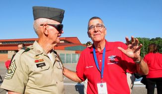 In this May 1, 2015 photo, retired U.S. Army Sgt. Maj. Adna Chaffee IV, left, and Luis Carreras talk during a veterans event at Hunter Army Airfield in Savannah, Ga. Chaffee and Carreras are helping organize a June homecoming celebration for Vietnam veterans at nearby Fort Stewart. The event comes as veterans this year mark the 50th anniversary of the Vietnam War. (AP Photo/Russ Bynum)