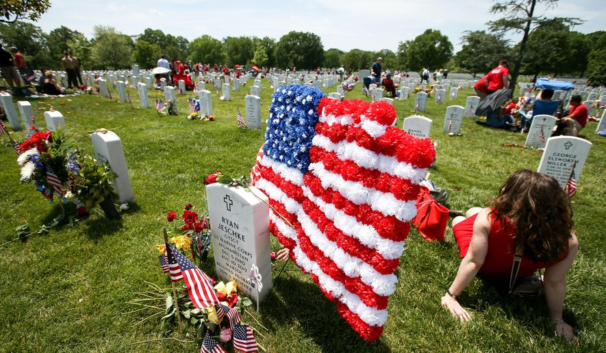 Section 60, where many of the soldiers who died in Iraq and Afghanistan are buried at Arlington National Cemetery in Arlington, Va.  (AP Photo/Andrew Harnik)