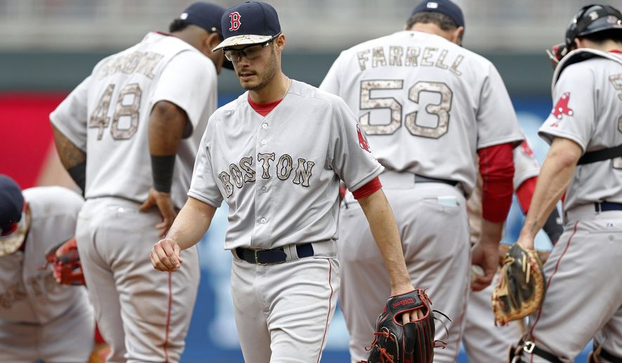 Boston Red Sox pitcher Joe Kelly leaves in the second inning of a baseball game after giving up seven runs to the Minnesota Twins, Monday, May 25, 2015, in Minneapolis. (AP Photo/Jim Mone)