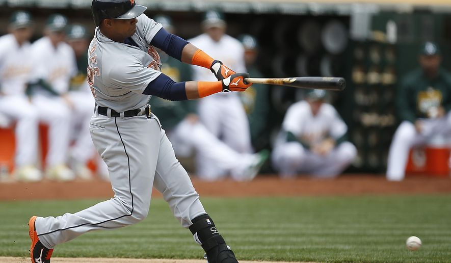 Detroit Tigers' Yoenis Cespedes (52) hits a single against the Oakland Athletics in the second inning of a baseball game Monday, May 25, 2015, in Oakland, Calif. (AP Photo/Tony Avelar)