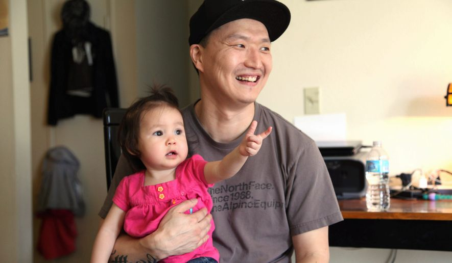 Adam Crapser, 40, who now has a wife and children including 1-year-old Christal, was adopted from South Korea when he was young, but his adoptive parents neglected to make him a U.S. citizen and re-homed him. (Associated Press)