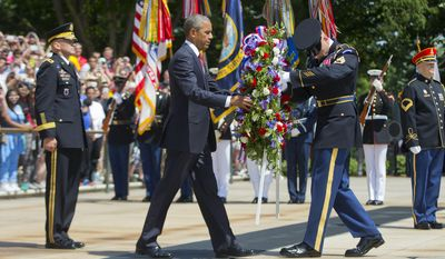 President Obama, accompanied by Maj. Gen. Jeffrey S. Buchanan, left, commander of the U.S. Army Military District of Washington, lays a wreath at the Tomb of the Unknowns, with the aid of Sgt. 1st Class John C. Wirth, on Memorial Day, Monday, May 25, 2015, at Arlington National Cemetery in Arlington, Va. (AP Photo/Pablo Martinez Monsivais)