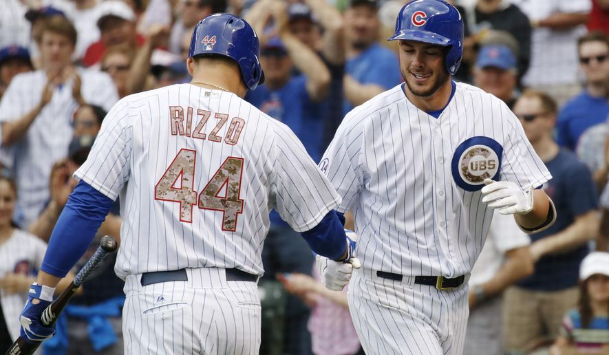After hitting a solo home-run, Chicago Cubs' Kris Bryant, right, celebrates with teammate Anthony Rizzo (44) during the first inning of a baseball game against the Washington Nationals Monday, May 25, 2015, in Chicago. (AP Photo/Andrew A. Nelles)