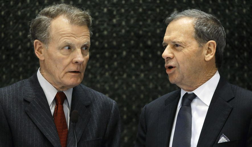 FILE - In a Feb. 18, 2015, file photo, Illinois House Speaker Michael Madigan, D-Chicago, left, and Senate President John Cullerton, D-Chicago, talk on the floor of the General Assembly in Springfield, Ill. Lawmakers enter the final scheduled week of the spring session Monday, May 25, 2015, with a number of big agenda items to deal with, if Republican Gov. Bruce Rauner and Democratic leaders can overcome their stalemate. (AP Photo/Seth Perlman, File)