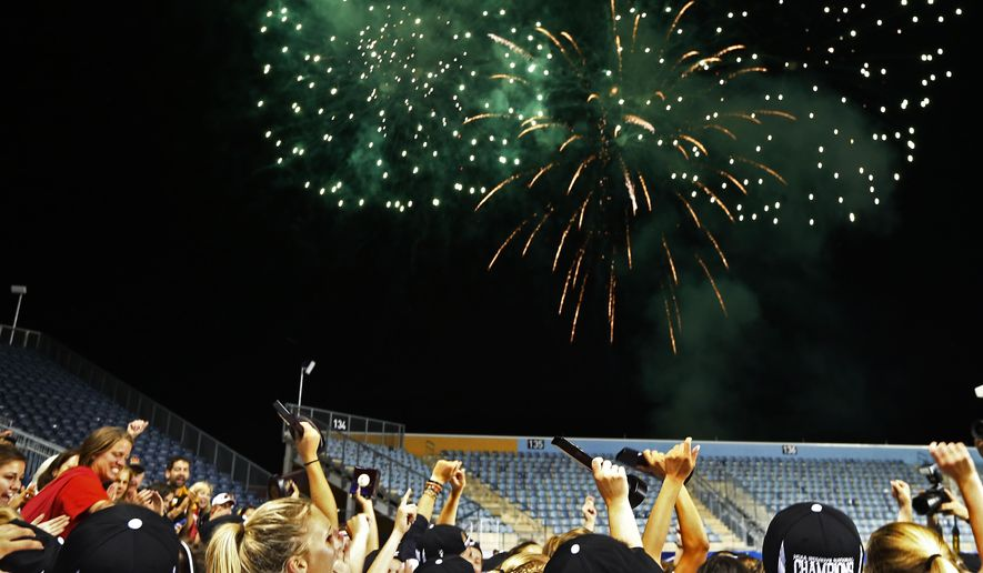 Maryland players watch fireworks explode after defeating North Carolina 9-8 in the championship match in the NCAA Division I women's lacrosse tournament, Sunday, May 24, 2015, Chester, Pa. (AP Photo/Rich Schultz)