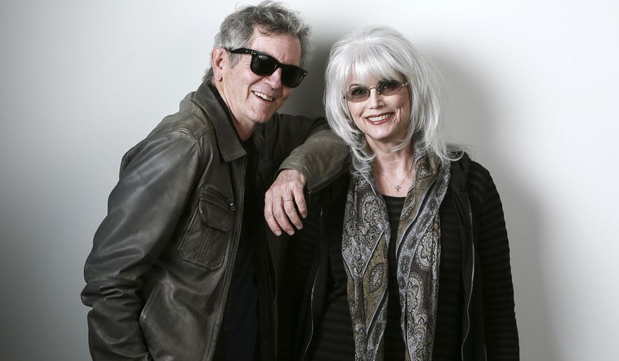 "In this April 30, 2015 photo, musicians Rodney Crowell, left, and Emmylou Harris pose for a portrait to promote their album ""The Traveling Kind"" in New York. (Photo by Amy Sussman/Invision/AP)"