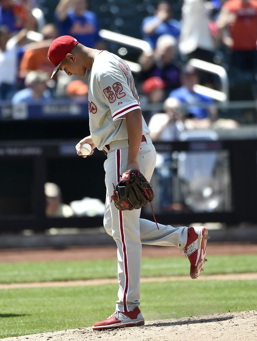 Philadelphia Phillies starting pitcher Severino Gonzalez (52) reacts on the mound after New York Mets left fielder Michael Cuddyer hits a solo home run in the fourth inning of a baseball game at Citi Field on Monday, May 25, 2015, in New York. (AP Photo/Kathy Kmonicek)