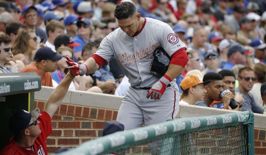 Washington Nationals catcher Wilson Ramos (40) heads to the dugout after hitting a solo home-run against the Chicago Cubs during the sixth inning of a baseball game Monday, May 25, 2015, in Chicago. (AP Photo/Andrew A. Nelles)