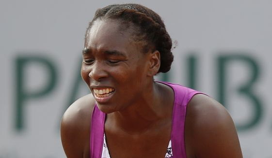 Venus Williams of the U.S. gestures after missing a return in the first round match of the French Open tennis tournament against Sloane Stephens of the U.S. at the Roland Garros stadium, in Paris, France, Monday, May 25, 2015. (AP Photo/Michel Euler)