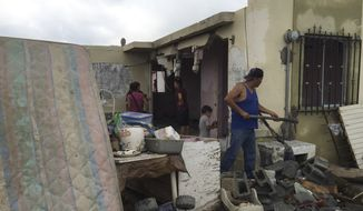 "Residents clear away debris from their home after a powerful tornado swept past in Ciudad Acuna, northern Mexico, Monday, May 25, 2015. A tornado raged through the city on the U.S.-Mexico border Monday, destroying homes and flinging cars like matchsticks. At least 13 people were killed, authorities said. The twister hit a seven-block area, which Victor Zamora, interior secretary of the northern state of Coahuila, described as ""devastated."" (AP Photo)"