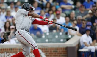 Washington Nationals' Denard Span connects for a home-run against the Chicago Cubs during the first inning of a baseball game Monday, May 25, 2015, in Chicago. (AP Photo/Andrew A. Nelles)