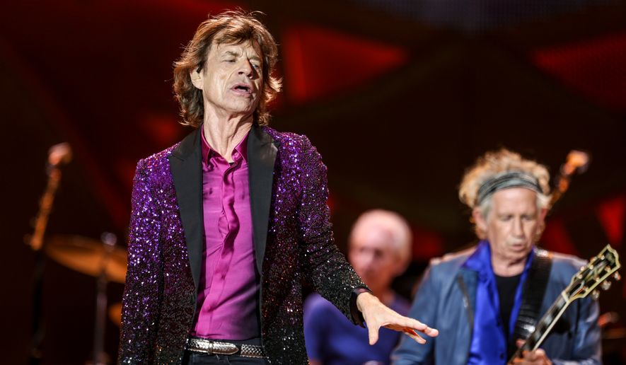 Mick Jagger, from left, Charlie Watts and Keith Richards perform at The Rolling Stones Zip Code Tour opening night at Petco Park on Sunday, May 24, 2015, in San Diego. (Photo by Rich Fury/Invision/AP)