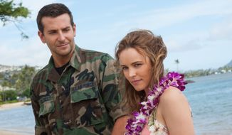 "This photo provided by Sony Pictures Entertainment shows Bradley Cooper, left, and Rachel McAdams in a scene from Columbia Pictures' ""Aloha."" The movie releases in U.S. theaters on May 29, 2015. (Neal Preston/Sony Pictures Entertainment via AP)"