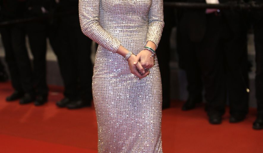 FILE- In this May 19, 2015 file photo, actress Emily Blunt poses for photographers as she leaves following the screening of the film Sicario at the 68th international film festival, Cannes, southern France. Fashion highlights from the  68th Cannes international film (AP Photo/Lionel Cironneau, File)