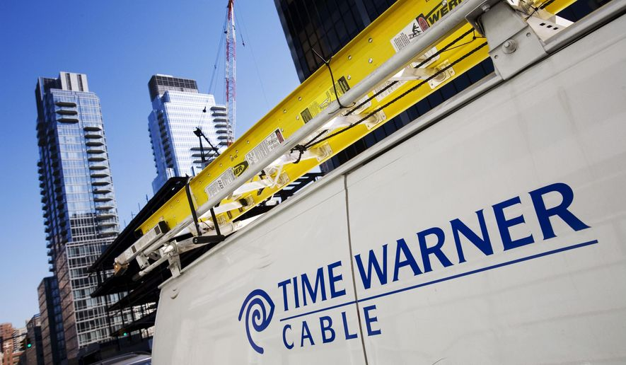 FILE - This Feb. 2, 2009 file photo shows a Time Warner Cable truck in New York .Charter Communications is close to buying Time Warner Cable for about $55 billion, two people familiar with the negotiations said Monday, May 25, 2015. (AP Photo/Mark Lennihan, File)