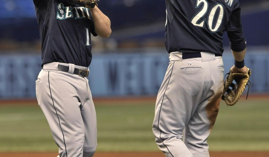 Seattle Mariners' Kyle Seager, left, and Logan Morrison (20) celebrate the team's 7-6 win over the Tampa Bay Rays in 10 innings in a baseball game Tuesday, May 26, 2015, in St. Petersburg, Fla. Seager had three hits, including two home runs, and drove in six runs for the Mariners. (AP Photo/Steve Nesius)