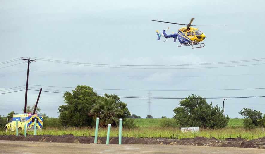 Star flight looks for a place to land after recuing a man at Weiss and Cele road in Pflugerville, Texas on Monday, May 25, 2015. (Ricardo B. Brazziell/Austin American-Statesman via AP)