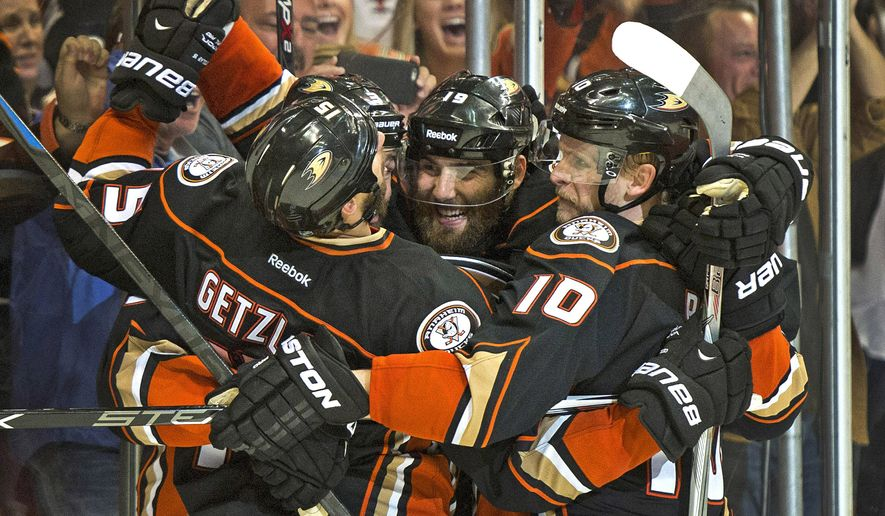 Anaheim Ducks left wing Patrick Maroon (19) is surrounded by his teammates after scoring against the Chicago Blackhawks in the third period in Game 5 of the Western Conference final of the NHL hockey Stanley Cup playoffs, Monday, May 25, 2015, in Anaheim, Calif. Anaheim won 5-4 in overtime. (Michael Goulding/The Orange County Register via AP)