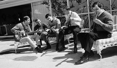 Gary Lewis, son of comedian Jerry Lewis (center), rehearses with his rock group The Playboys in 1965. Mr. Lewis has been making music for nearly 52 years. (Associated Press)