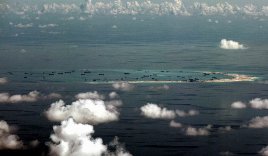atoll: China's alleged ongoing reclamation of Mischief Reef in the Spratly Islands in the South China Sea is raising notices of Western nations concerned China may be attempting to assert dominance. (Associated Press)