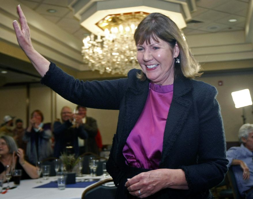 In this Nov. 6, 2012 file photo, then-congressional candidate Ann Kirkpatrick, D-Arizona, waves as she enters a room full of supporters during an election night in Flagstaff, Ariz.  Kirkpatrick on Tuesday, May 26, 2015, said she will challenge Republican John McCain for his Senate seat in 2016, launching an uphill bid to unseat the five-term senator in the GOP-leaning state. Kirkpatrick, 65, is serving her third House term in a district she has won narrowly. (AP Photo/Ralph Freso, File)