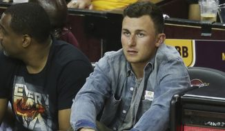 Cleveland Browns quarterback Johnny Manziel watches during the second half in Game 3 of the Eastern Conference finals of the NBA basketball playoffs between the Atlanta Hawks and Cleveland Cavaliers Sunday, May 24, 2015, in Cleveland. (AP Photo/Ron Schwane)