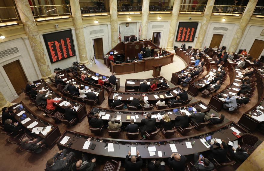 State representatives gather in the House chamber at the state Capitol in Little Rock, Ark., Tuesday, May 26, 2015. Arkansas lawmakers have begun a special legislative session focusing on an $87 million incentive package aimed at helping Lockheed Martin land a major defense contract. (AP Photo/Danny Johnston)