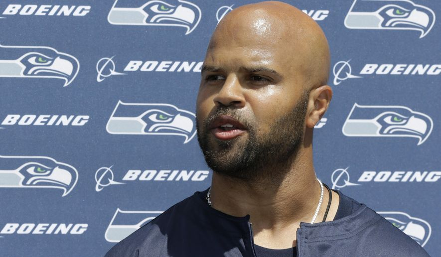 Seattle Seahawks defensive coordinator Kris Richard talks to reporters following an organized team activity Tuesday, May 26, 2015, in Renton, Wash. (AP Photo/Ted S. Warren)
