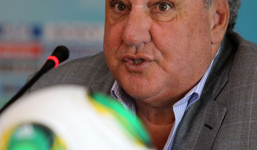 FILE - In this Friday, July 12, 2013 file photo, Jim Boyce, chairman of the FIFA tournament organizing committee speaks during a news conference in Istanbul. Boyce's power as FIFA vice president will end on Friday May 29, 2015, when the British vice presidency and the $200,000 annual pay goes to former Manchester United chief executive David Gill. (AP Photo/Thanassis Stavrakis, File)