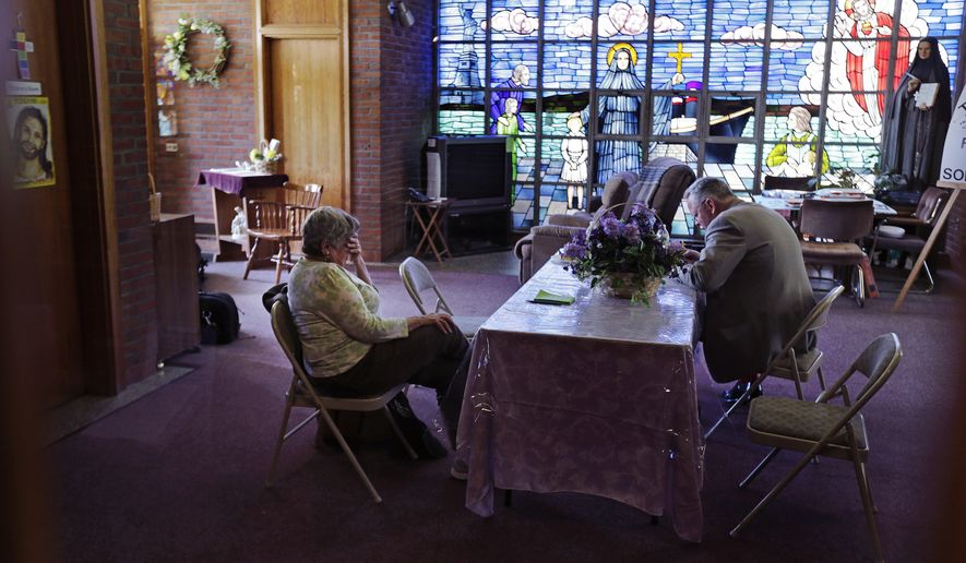 Barbara Nappa, of Scituate, Mass., left, sits with Jon Rogers during a vigil at the St. Frances Xavier Cabrini Church in Scituate, Mass., Wednesday, May 20, 2015. (AP Photo/Charles Krupa)