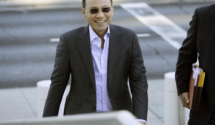 "FILE - In this Nov. 6, 2014 file photo, Wei Seng ""Paul"" Phua walks into federal court in Las Vegas. U.S. District Judge Andrew Gordon on Tuesday, May 26, 2015 has thrown out evidence collected by FBI agents who posed as Internet repairmen during a Las Vegas Strip illegal bookmaking investigation, and is giving prosecutors until Friday to decide whether to drop criminal charges altogether. Defense lawyer David Chesnoff said Tuesday the rulingalmost completely undercuts the case against Malaysian businessman Wei Seng ""Paul"" Phua. (AP Photo/John Locher, File)"