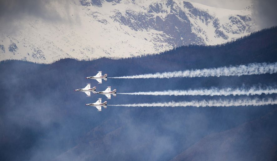 The Air Force Thunderbirds practice in the skies above The United States Air Force Academy in Colorado Springs, Colo., Tuesday, May 26, 2015, in preparation for Thursday's Air Force Academy Graduation. (Mark Geis/The Gazette via AP)