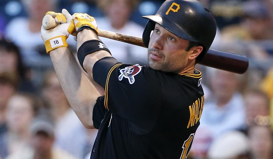 Pittsburgh Pirates' Neil Walker watches a two-run home run off Miami Marlins starting pitcher Jose Urena in the second inning of a baseball game in Pittsburgh, Tuesday, May 26, 2015. (AP Photo/Gene J. Puskar)