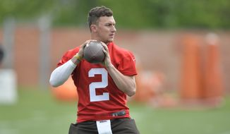 Cleveland Browns quarterback Johnny Manziel looks to pass during an NFL organized training activity in Berea, Ohio, Tuesday, May 26, 2015. (AP Photo/David Richard)