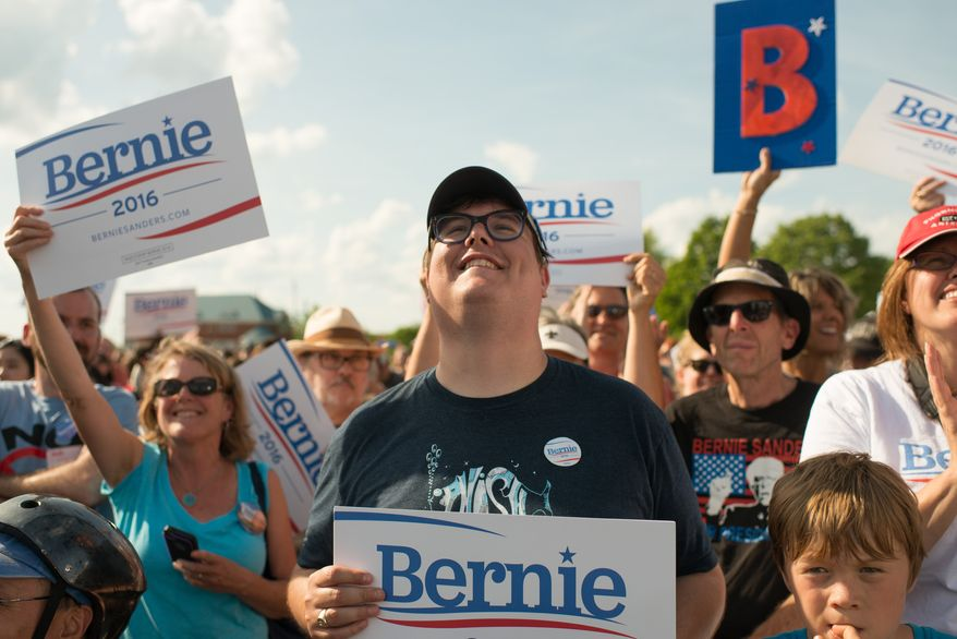 Supports cheer while Sen. Bernie Sanders, I-Vt., speaks on Tuesday, May 26, 2015 in Burlington, Vt., where he formally announced he will seek the Democratic nomination for president. (AP Photo/Andy Duback)