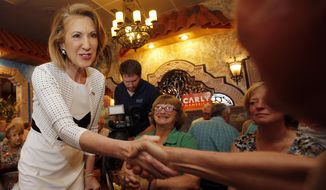 Republican presidential candidate, former Hewlett-Packard CEE Carly Fiorina, reaches out to shake hands at a luncheon hosted by the Derry Republican Town Committee, Tuesday, May 26, 2015, in Derry, N.H. (AP Photo/Jim Cole)